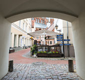 Medieval street in old Riga city, Latvia Royalty Free Stock Photo