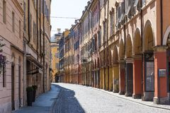 Medieval street in old town of Modena, Italy Royalty Free Stock Photography