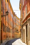 Medieval street in old town of Modena, Italy Royalty Free Stock Photos