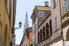 Medieval street in old town of Modena, Italy Stock Photos