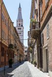 Medieval street in old town of Modena, Italy Royalty Free Stock Photo