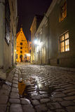 Medieval street in old town at night Stock Photo