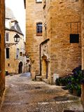 Medieval street in the old town of Sarlat, Dordogne, France. Medieval lane in the picturesque old town of Sarlat, Dordogne, France Royalty Free Stock Images