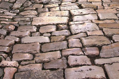 Medieval street paved with the cobble stones Royalty Free Stock Photo