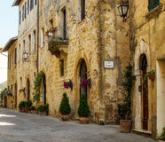 A medieval street of Pienza, Italy. Stock Photos