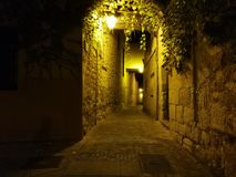 Medieval street of timeless lights stock photos