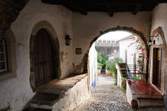 Medieval street in the  town of Obidos, Portugal Royalty Free Stock Photo