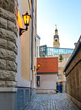 Medieval street with view on renovated city hall, Riga, Latvia Royalty Free Stock Photography