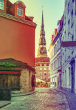 Medieval street with view on Saint Peter church, Riga, Latvia Royalty Free Stock Images