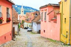 Medieval street view in Sighisoara, Romania Stock Photo
