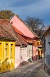 Medieval paved street in Sighisoara, Transylvania. Stock Photos
