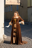 Medieval style girl at the street of tallinn Stock Photo