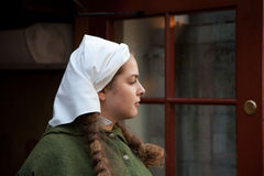 Medieval style girl at the street of  tallinn Royalty Free Stock Image