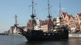 Medieval style ship carrying tourists down river in old European city, timelapse. Stock footage stock footage