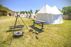 Medieval style tent and camp fire. Royalty Free Stock Photo