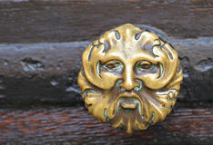 Medieval styles handle from entry gates Royalty Free Stock Images