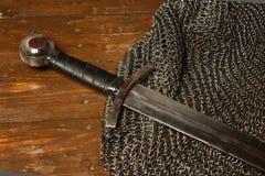 Medieval sword and hauberk Stock Photo