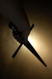 Medieval sword silhouette at backlighting Royalty Free Stock Photos