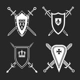 Medieval Shields Set. Medieval swords and shields. Heraldic design elements useful for creating logos, icons, badges and emblems. Vector illustration in white royalty free illustration