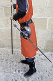 Medieval swordsman. Detail of a person dressed in a medieval feast, warrior Royalty Free Stock Images