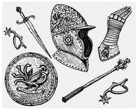 Medieval symbols, Helmet and gloves, shield with dragon and sword, knife and mace, spur vintage, engraved hand drawn in Stock Photos