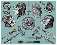 Medieval symbols, Helmet and gloves, shield with dragon and sword, knife and mace, spur vintage, engraved hand drawn in. Sketch or wood cut style, old looking Stock Images