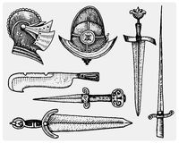 Medieval symbols, Helmet and swords, knife vintage, engraved hand drawn in sketch or wood cut style, old looking retro Stock Photo