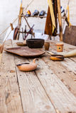 Medieval table. A big and old wooden table with some medieval items on it royalty free stock photography
