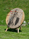 Medieval target. With arrows on a green grass Royalty Free Stock Photos