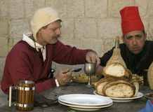 Medieval Tavern. MDINA, MALTA - APR10-  Men eating at a tavern during medieval reenactment in the old city of Mdina in Malta April 10, 2010 Stock Photos