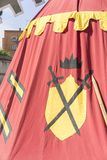medieval tent of different colors with coats of arms and blazons Royalty Free Stock Photos