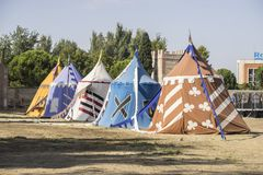 Medieval tents next to a field of fair or mourning between warri. Ors Stock Images