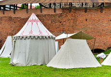 Medieval tents. View of historical medieval camp tents by the castle wall Royalty Free Stock Photography