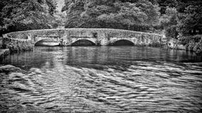 Medieval three arch sheep wash bridge in the Peak District. stock images