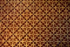 Medieval Tile Pattern. A yellow and red repetitive diamond motif incorporating four fleur-de-lis designs into a square pattern, found in the medieval floor Royalty Free Stock Photography