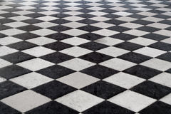 Medieval Tiled Floor. A medieval black and white tiled floor. Stone texture. Shot at the Chenonceau castle, Loire Valley France royalty free stock photos