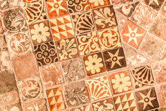 Medieval tiles. Background of ancient medieval floor tiles dating from the 13th century Stock Photography
