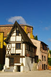Medieval timber framed house. Against old church in roanne in france Royalty Free Stock Photo