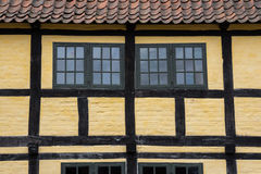 Medieval timbered yellow  brown house Stock Photography