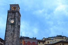 Medieval Torre Apponale tower in Riva del Garda in the evening, Italy. Medieval Torre Apponale tower in Riva del Garda in the evening in Italy royalty free stock image
