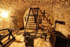 Medieval torture chamber with plenty of tools. Medieval torture chamber exposition with plenty of executioner& x27;s tools Royalty Free Stock Photo