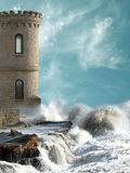 Medieval tower. With agitated coast Stock Photos