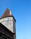 Medieval tower against the blue sky Stock Images