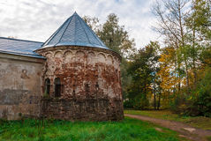 Medieval tower in autumn scene. Autumn landscape. Tower and wall of an abandoned medieval manor. Photographed in the town of Pushkin, Leningrad district, Russia Stock Photography
