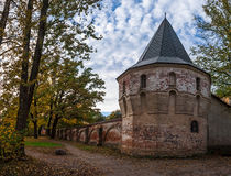 Medieval tower in autumn scene. Autumn landscape. Tower and wall of an abandoned medieval manor. Photographed in the town of Pushkin, Leningrad district, Russia Stock Photo