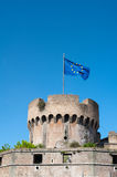 Medieval tower with blue european flag on top Royalty Free Stock Photography