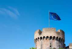Medieval tower with blue european flag on top Royalty Free Stock Photos