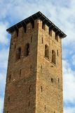 Medieval tower built with bricks for the defense Stock Photos