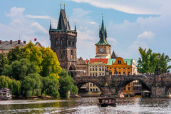 Medieval tower and Charles Bridge in Prague. Stock Photos