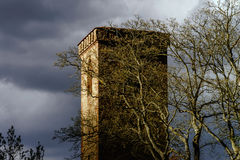 Medieval tower on dark stormy sky background Stock Photography
